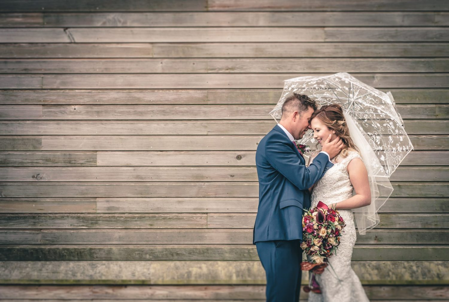 bride and groom with umbrella louth wedding