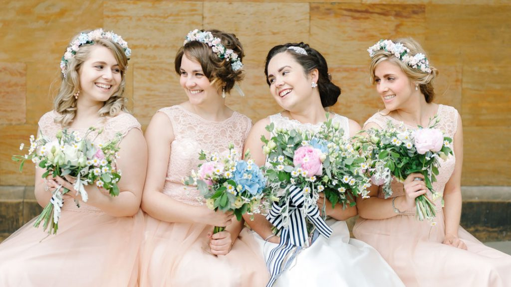 bridesmaids laughing sat at Lincoln castle