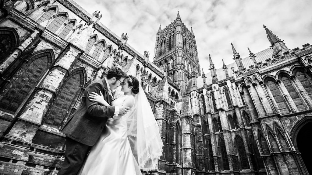 bride and groom outside Lincoln cathedral wedding