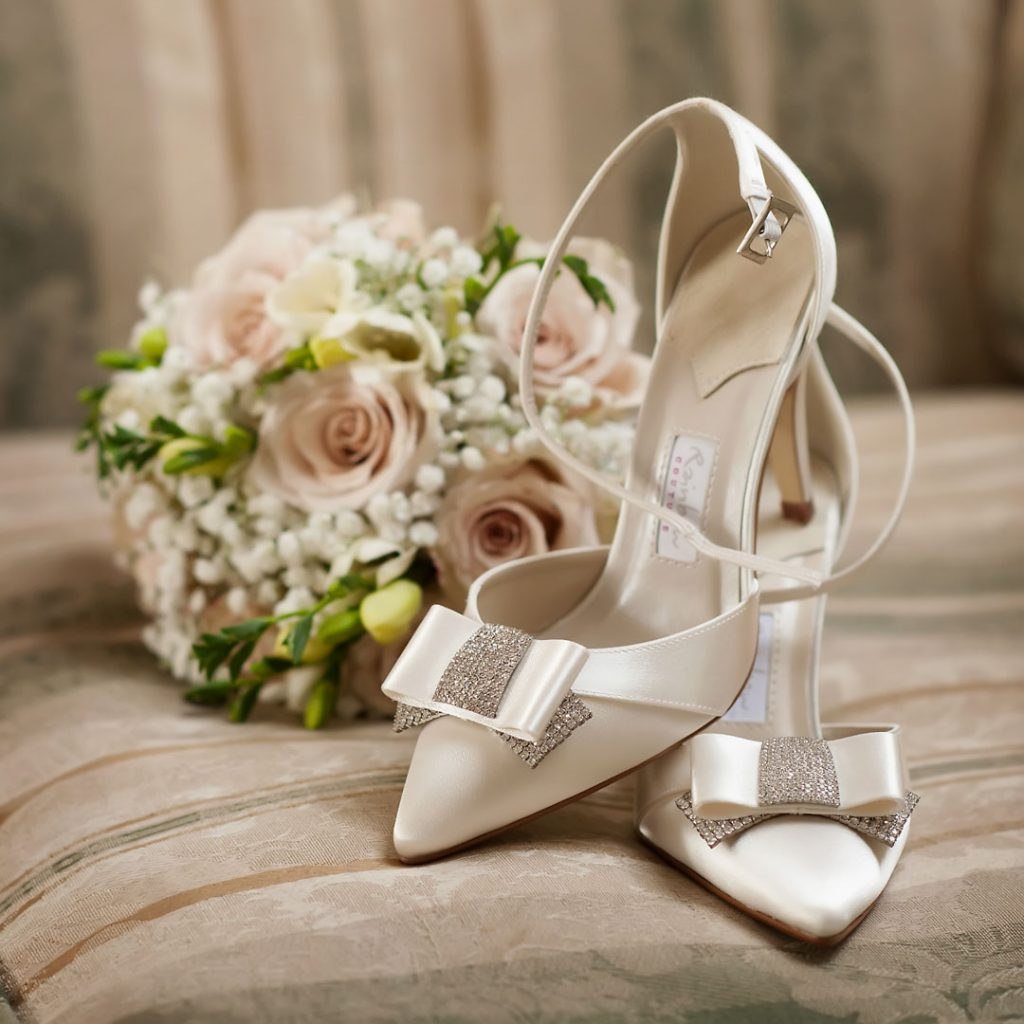brides cream shoes on chair