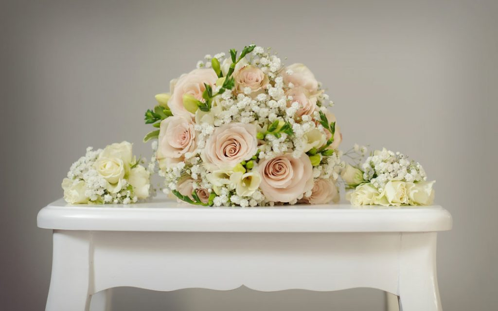 brides pink and cream bouquet on stool