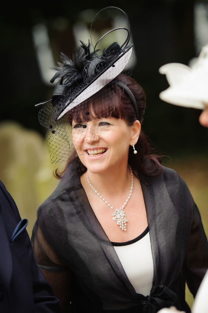 wedding guest in black hat
