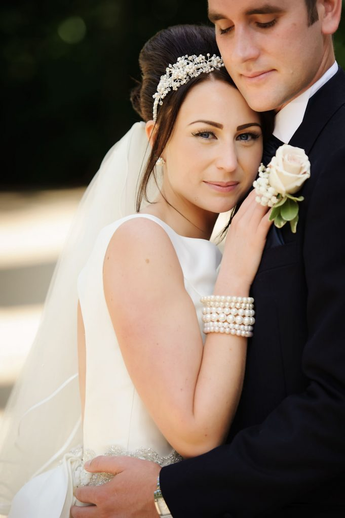 bride leans on chest of groom
