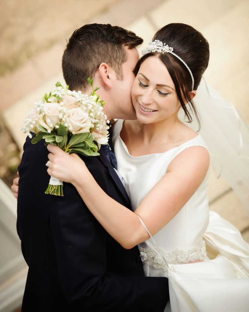 bride embraces groom at dower house