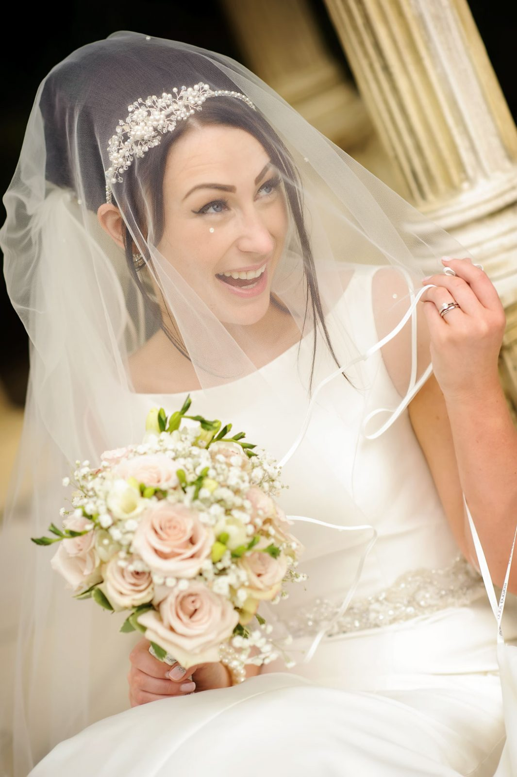 bride laughs through veil