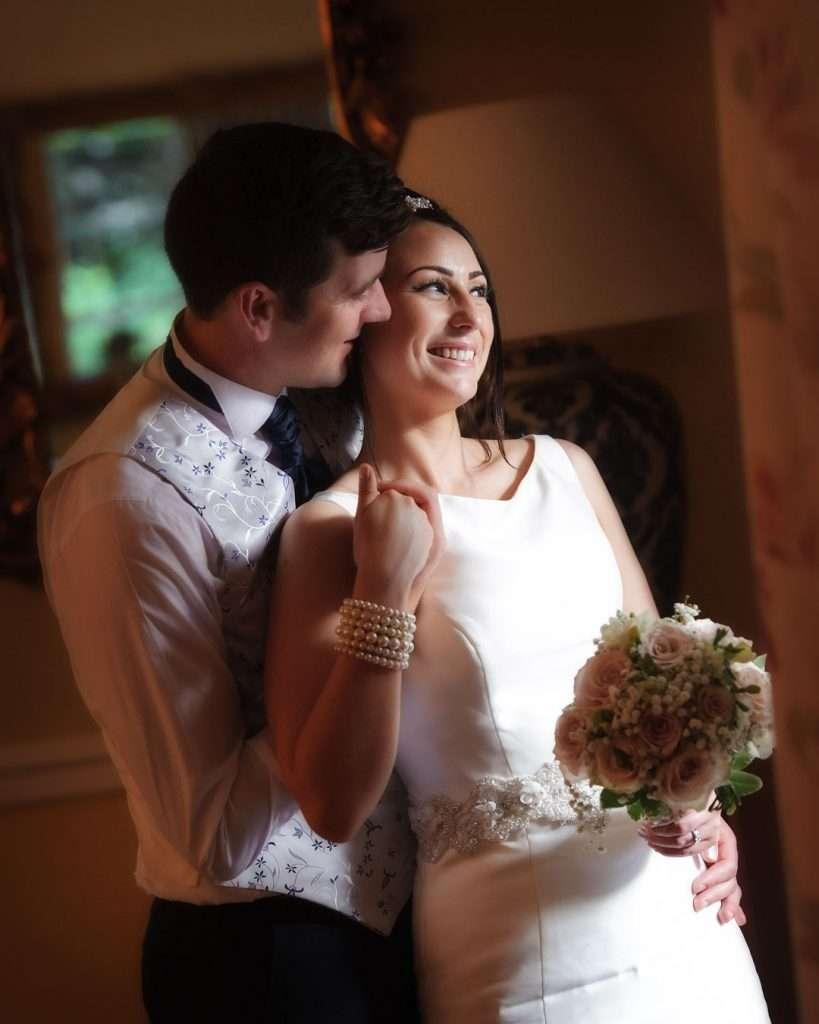 bride leans into groom at wedding reception