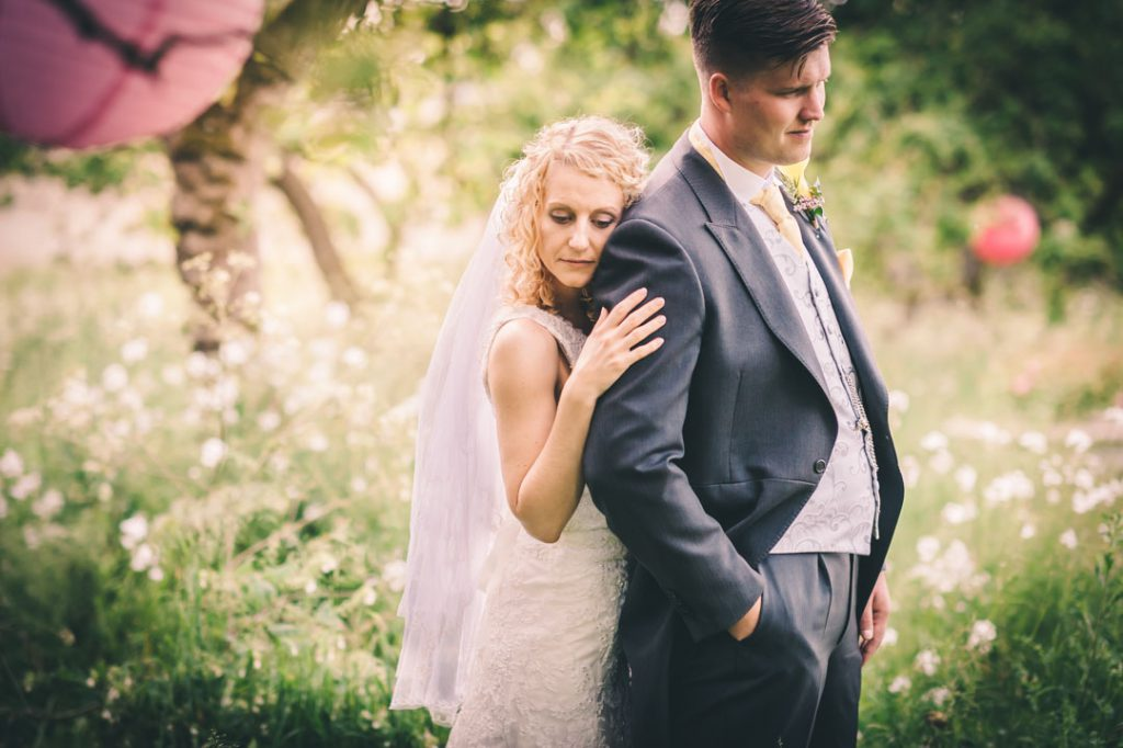 bride posing with groom at lincolnshire wedding venue
