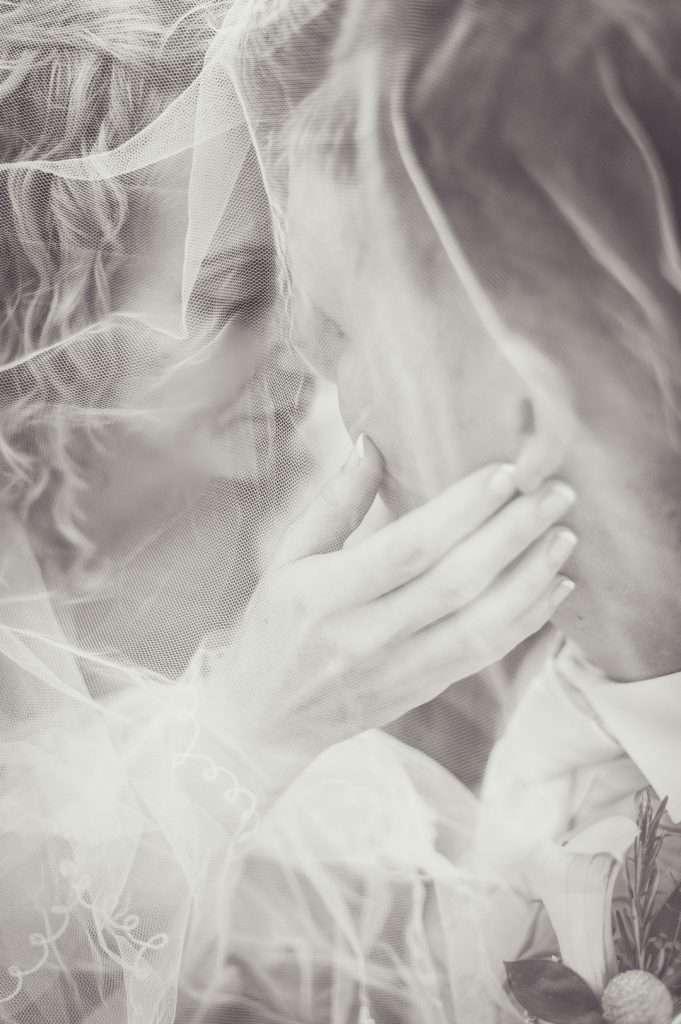 bride and groom romantic kiss anticipation