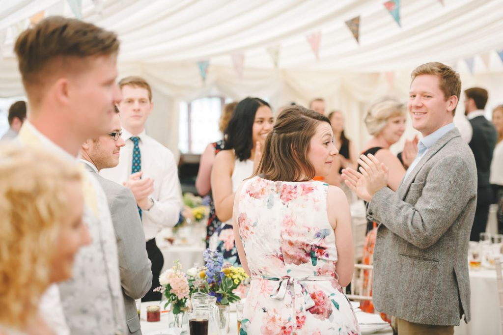 guests clapping arrival of bride and groom at wedding reception lincolnshire