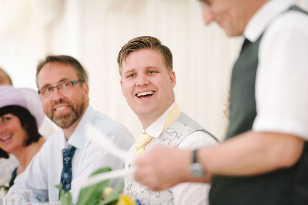 grom laughing at father of the bride