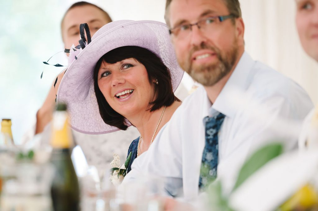 wedding guest laughing at father of the bride