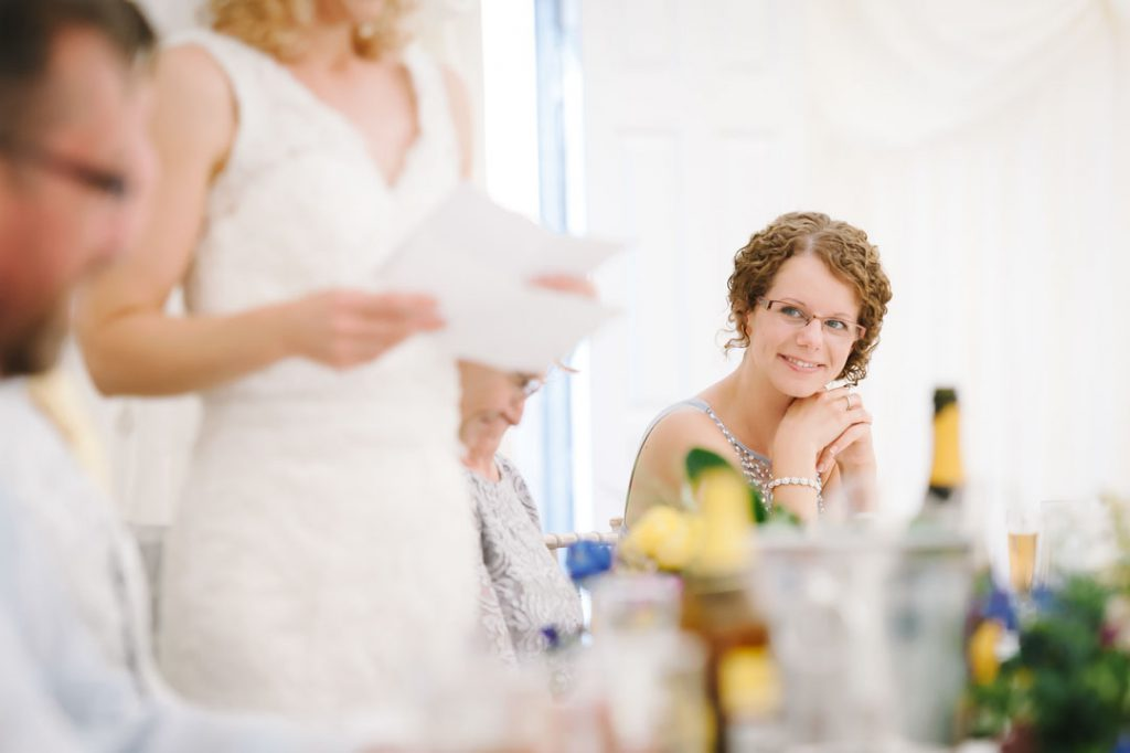 maid of honour smiles at bride