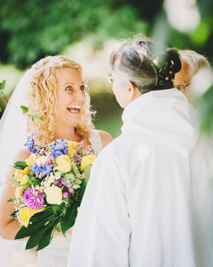 bride laughing at vicar