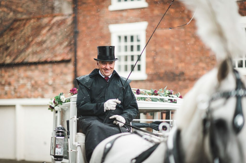 man on wedding carriage