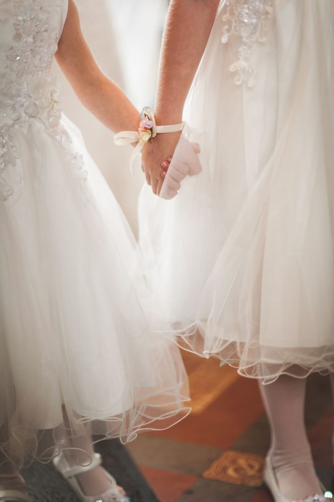 bridesmaids holding hands