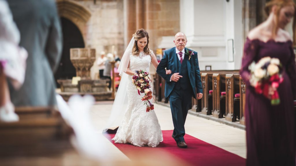 bride walking down isle with father st James louth