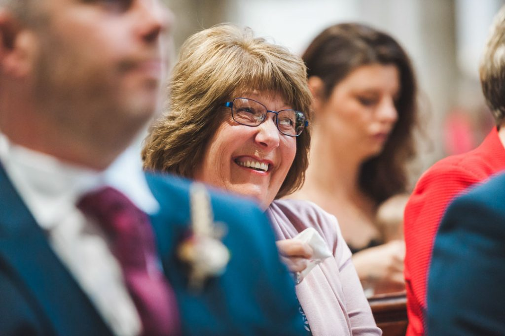wedding guest laughing inside church