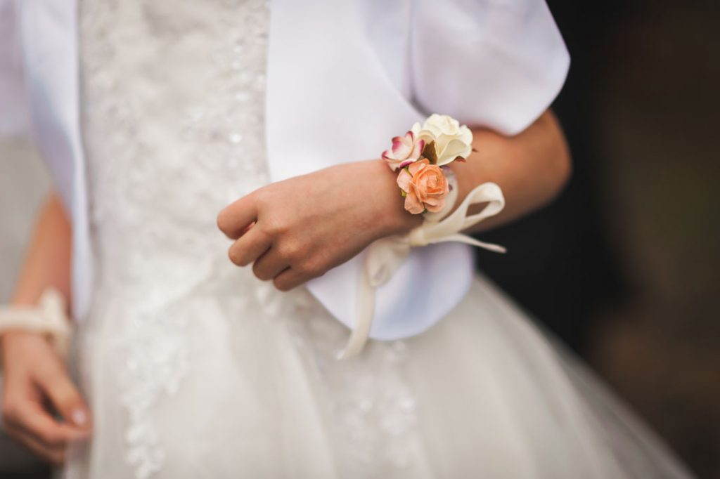 bridesmaid with wrist flowers