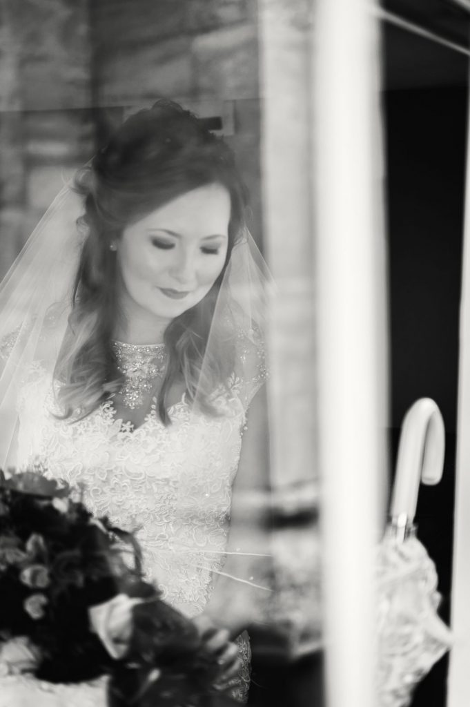 bride looking down inside carriage louth wedding photographers