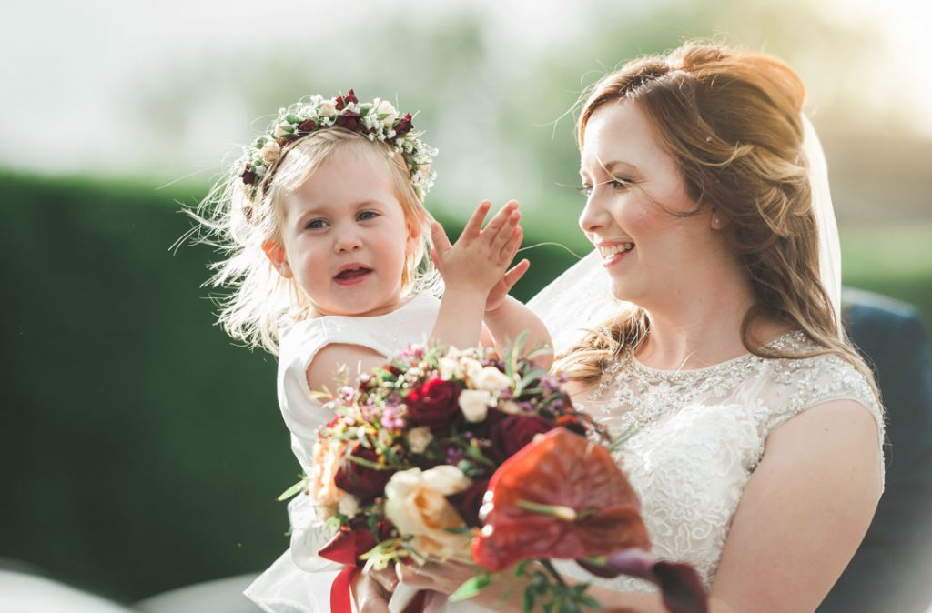 bride holding and laughing at child
