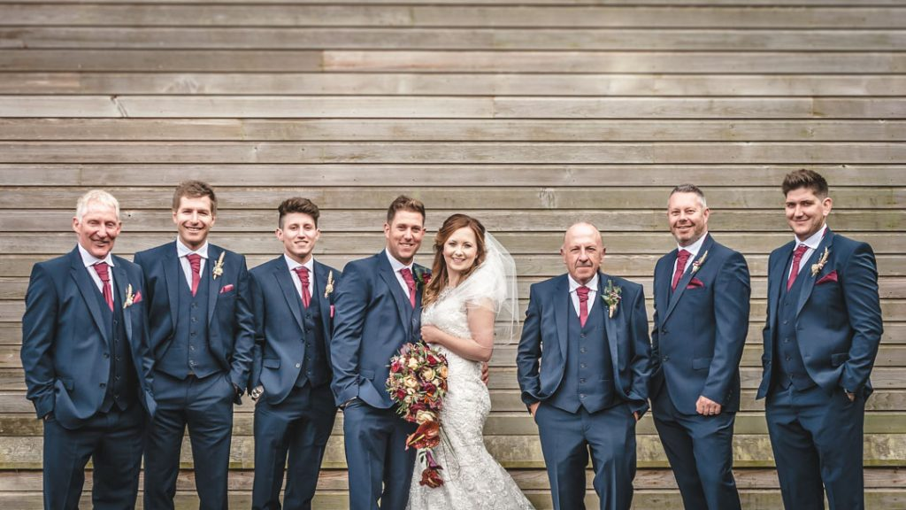 bride in group shot with bestmen and groom