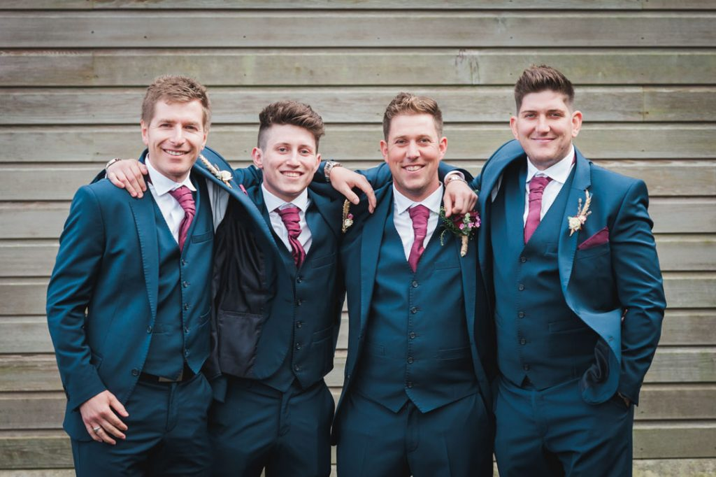 groomsmen hugging for louth wedding photographers