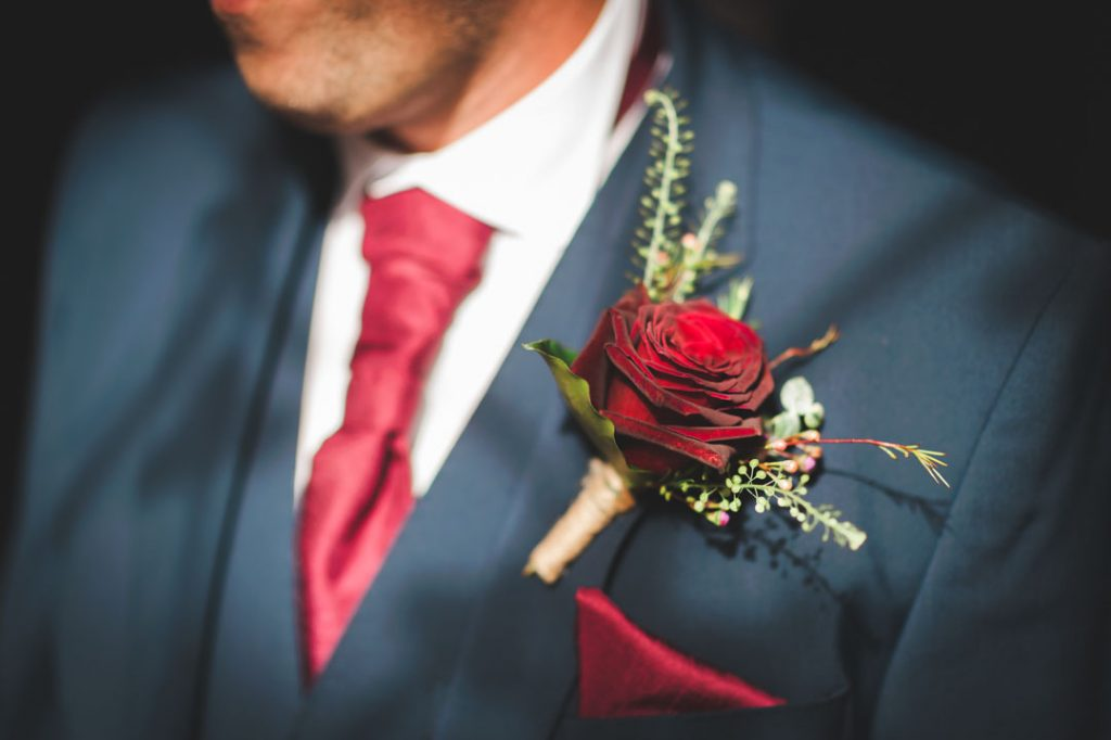 rose on lapel of groom