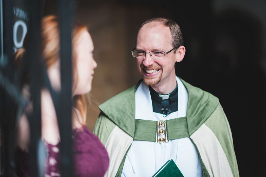 vicar laughing at bridesmaid