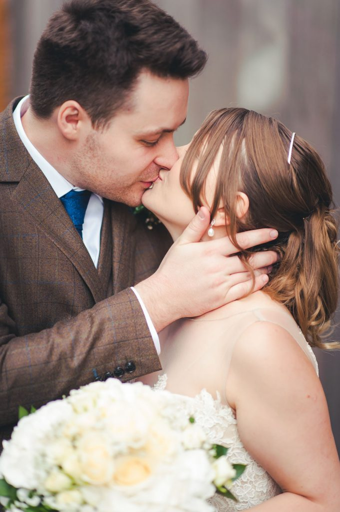 bride and groom kiss each other