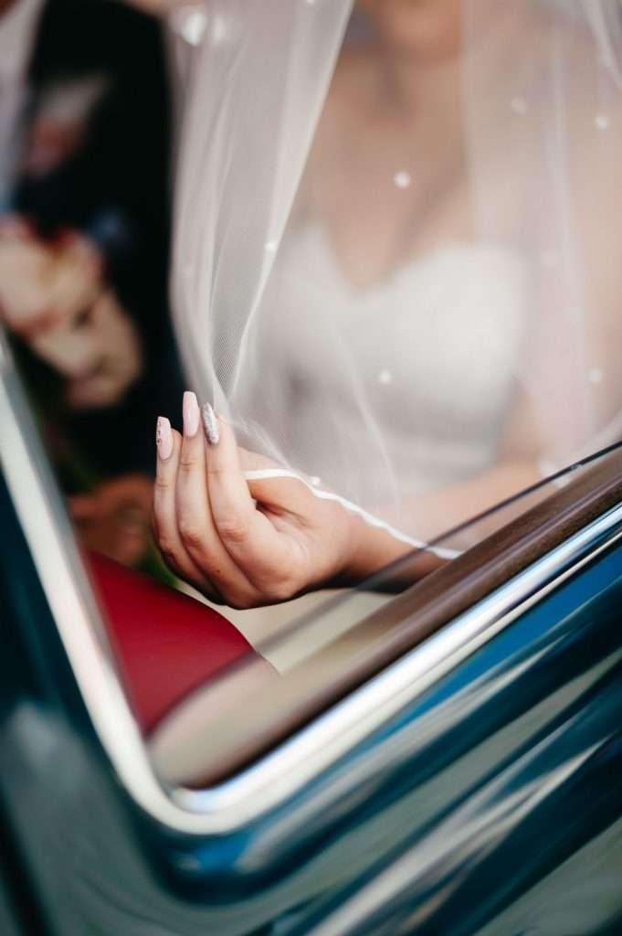 bride holding veil by finger tips