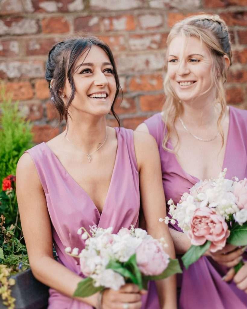 bridesmaids waiting outside church
