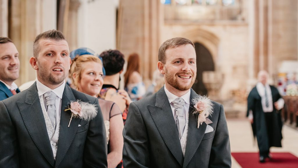 groom awaits bride in church