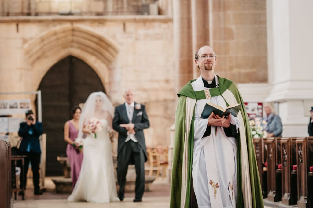 vicar walking down wedding isle