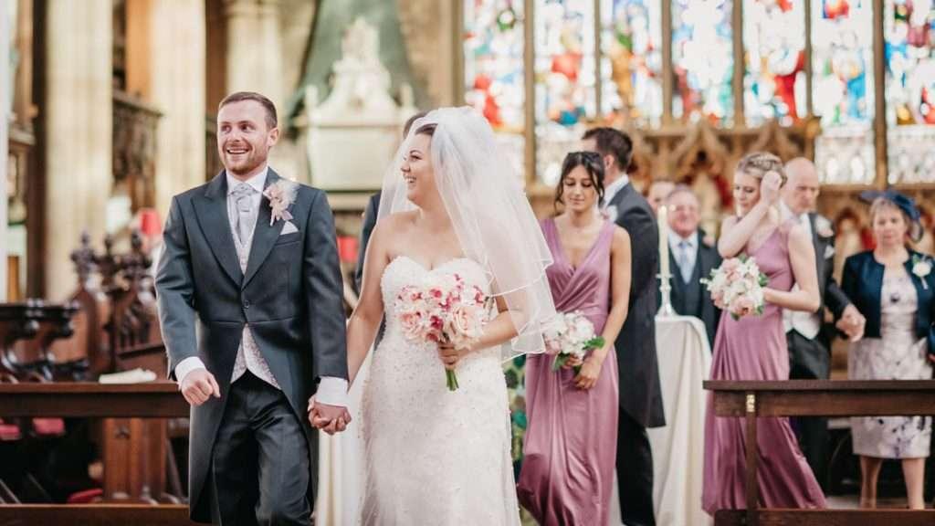 bride looks at groom in church isle