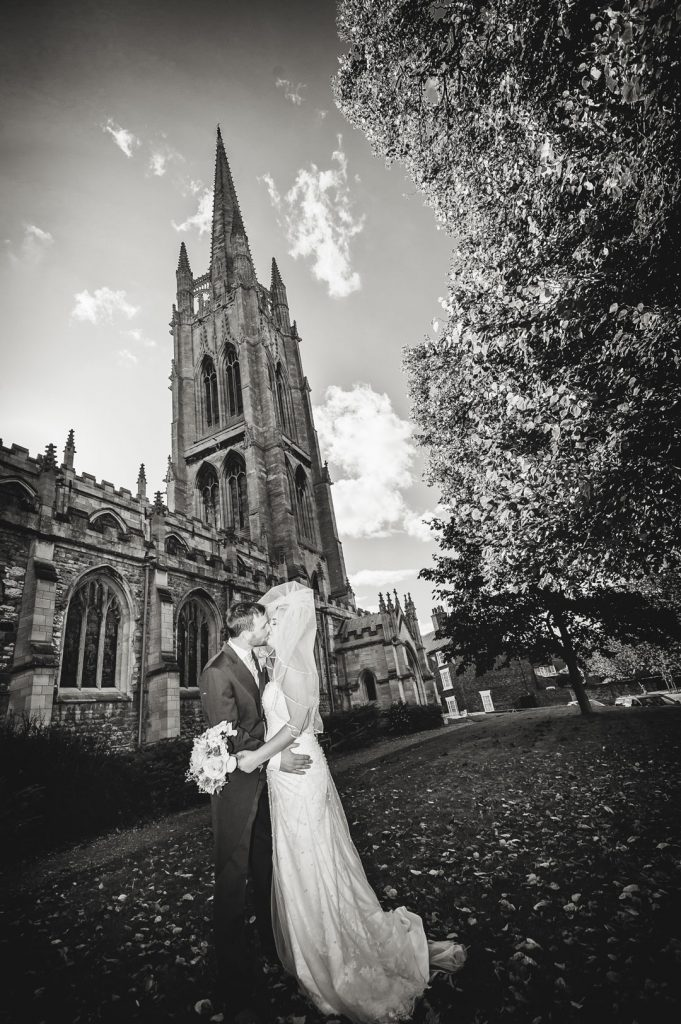 bride and groom kisses outside st James church louth
