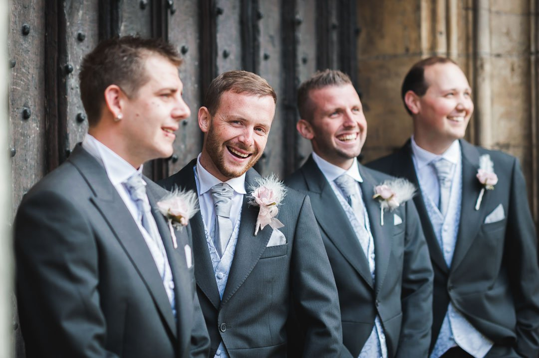 groom laughing with bestmen