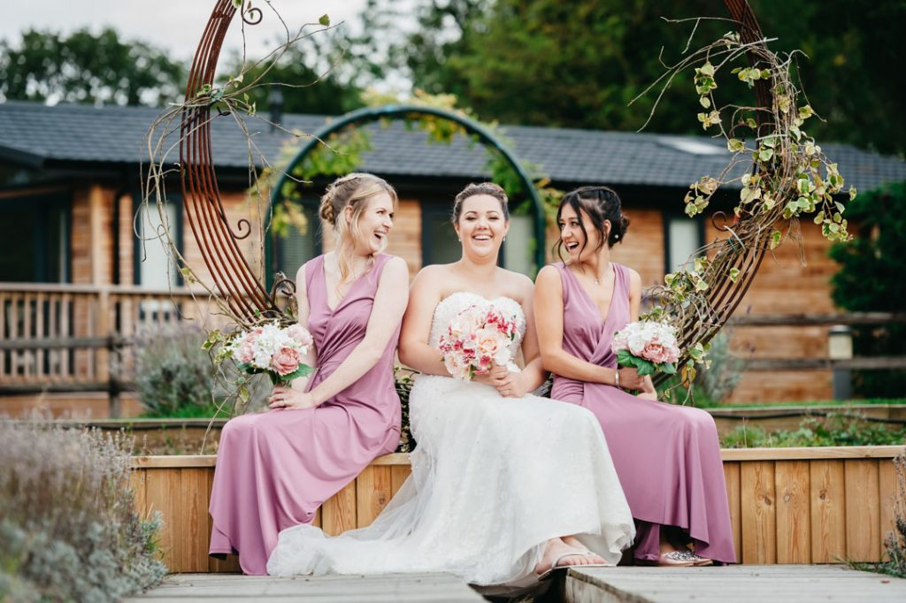 bride and bridesmaid in pink dresses