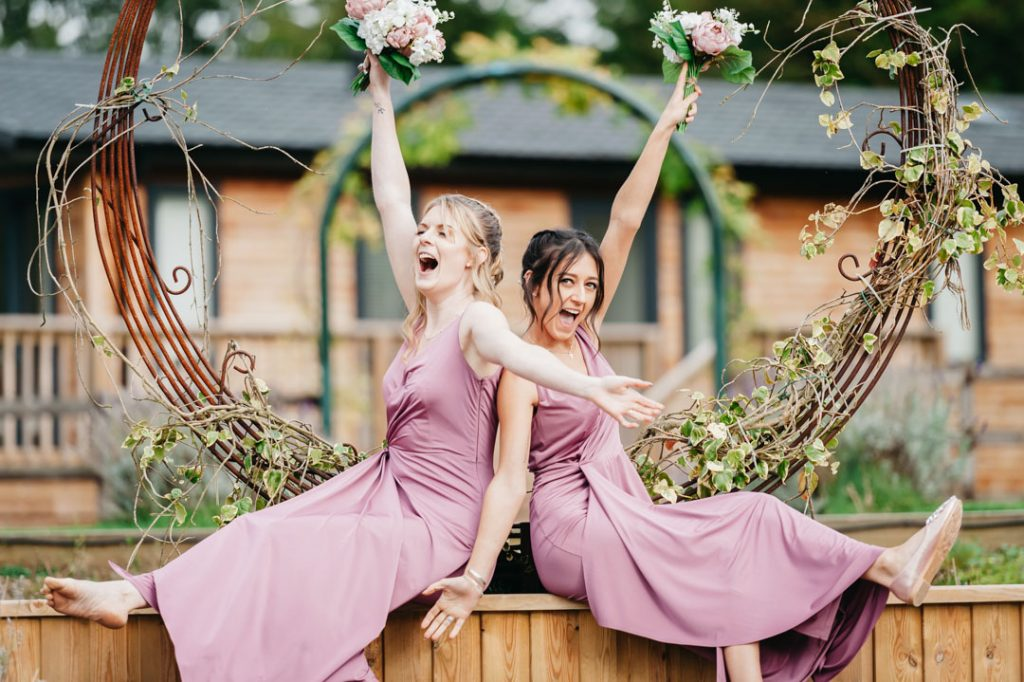 bridesmaids having fun in pink dresses