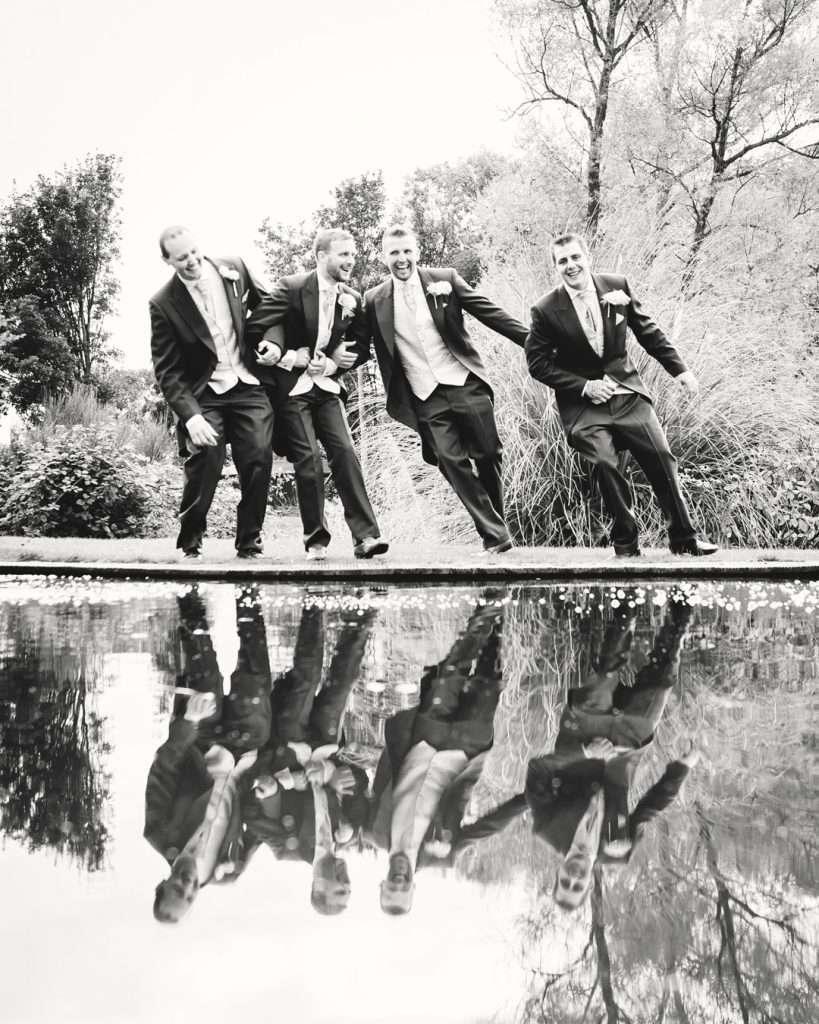 groomsmen jumping around