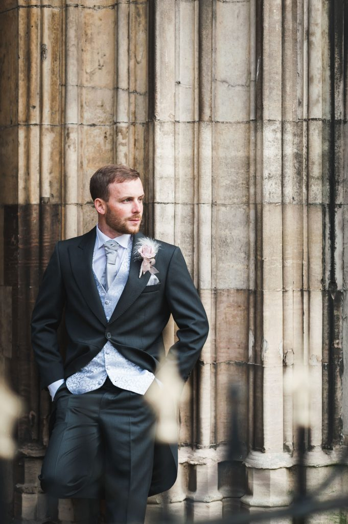 groom waits for guests at grimsby church