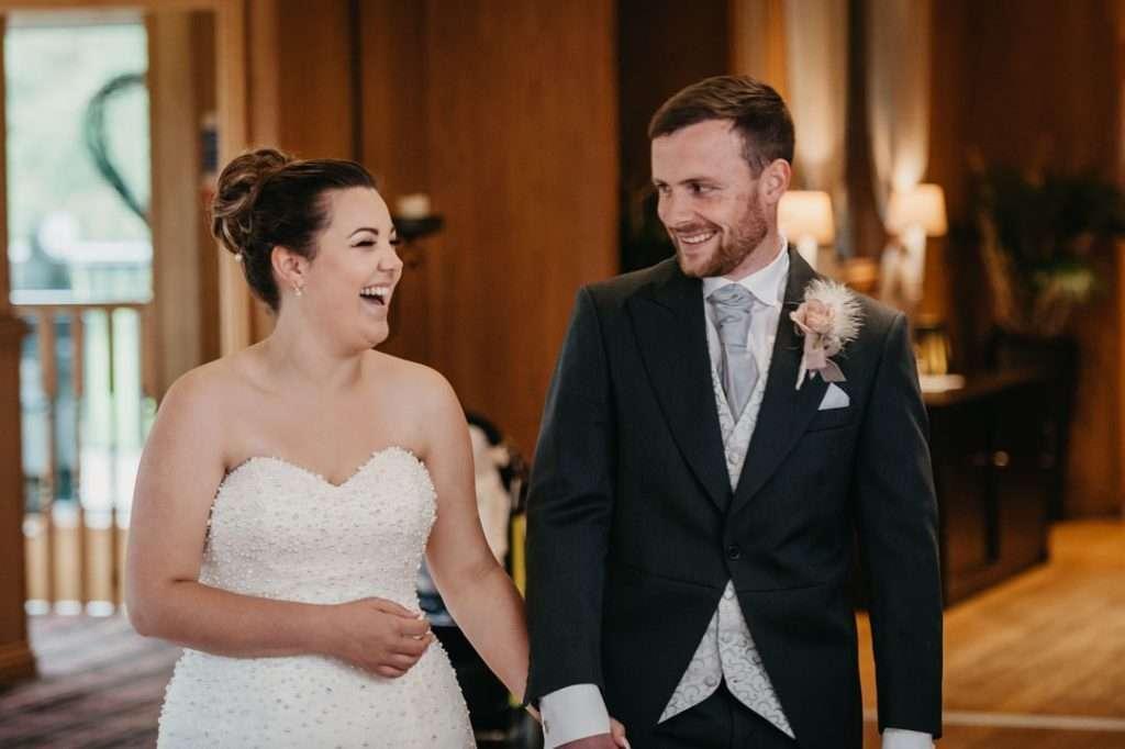 bride and groom enter reception at wedding