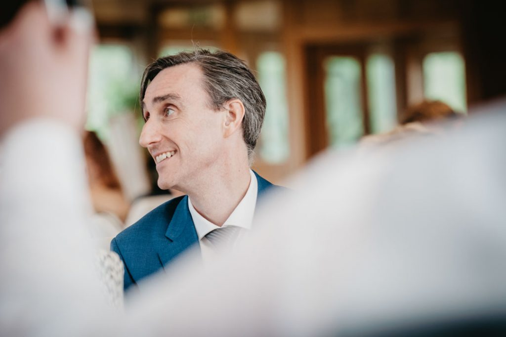 man in blue suit at wedding reception laceby manor grimsby