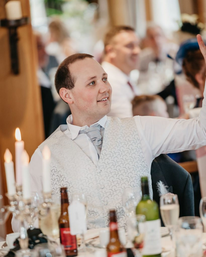 bestman sat listens to speech