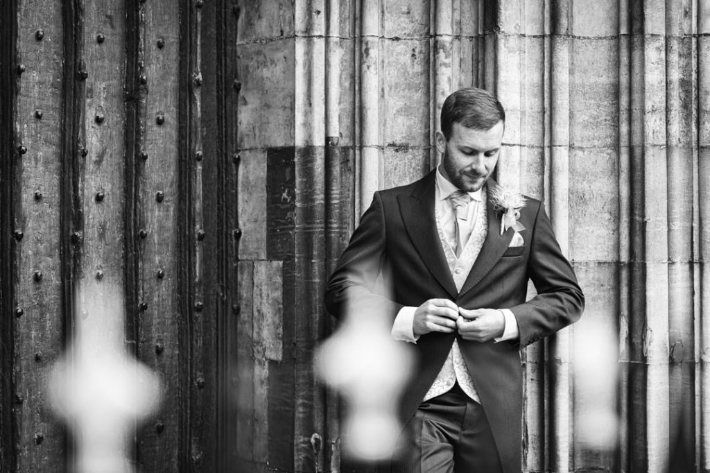 groom buttons jacket outside of grimsby church