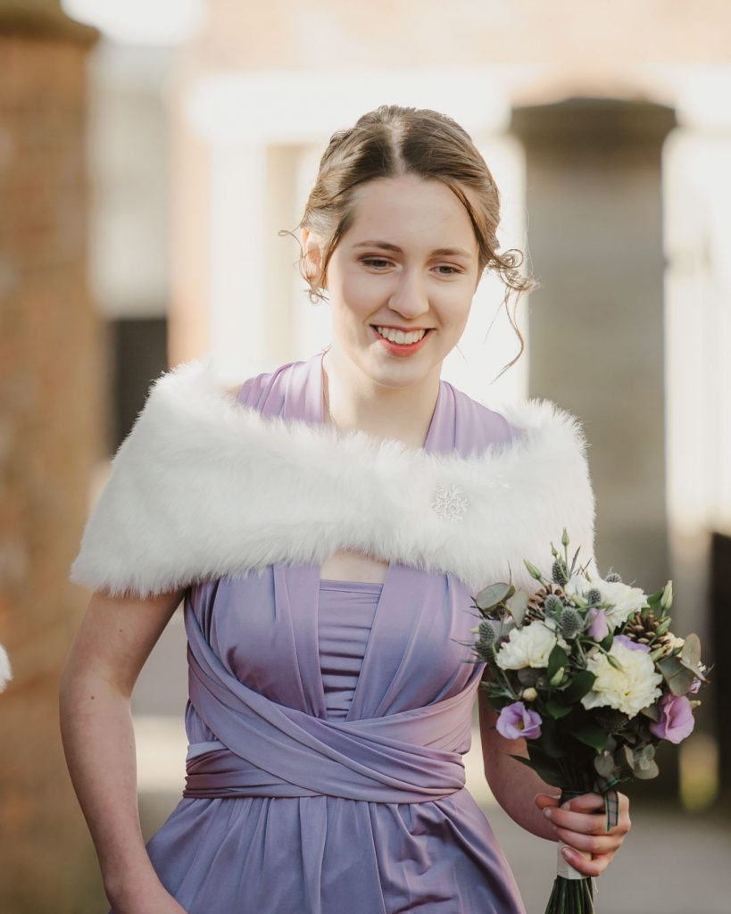 bridesmaid smiling in purple dress