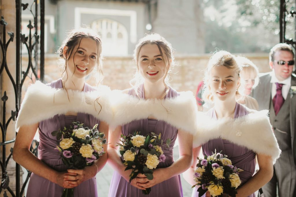 bridesmaids posing inside church