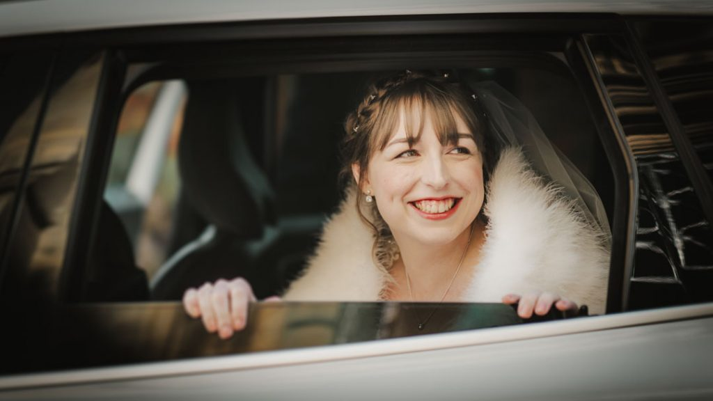bride looking out of car window