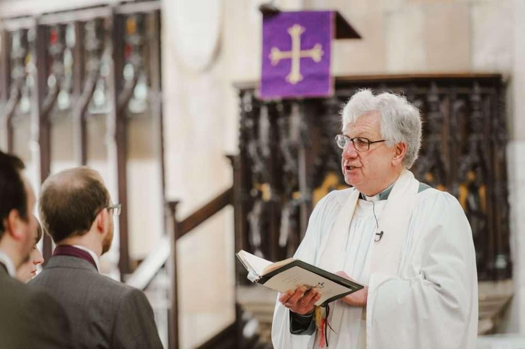 vicar giving wedding vows