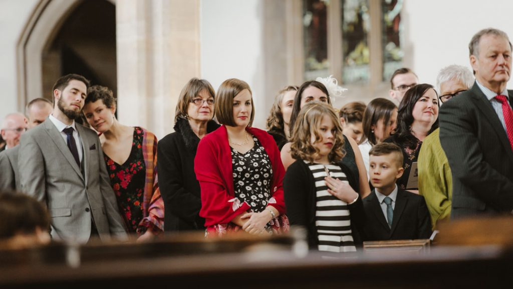 wedding guests watching in church