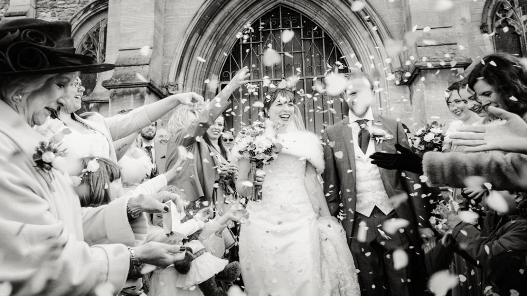 black and white confetti on groom and bride